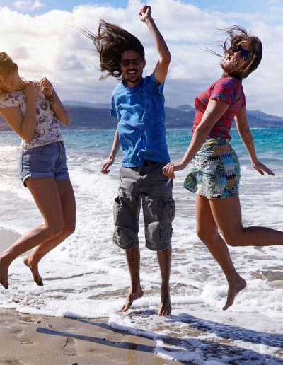 happy-peole-jumping-in-the-beach