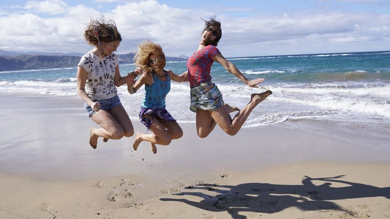 jumping-girls-in-the-beach-with-hand-printed-t-shirts
